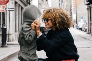 Mom smiling at son as she connects with her kid