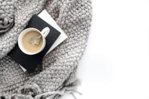 Cozy blanket with warm cup of tea