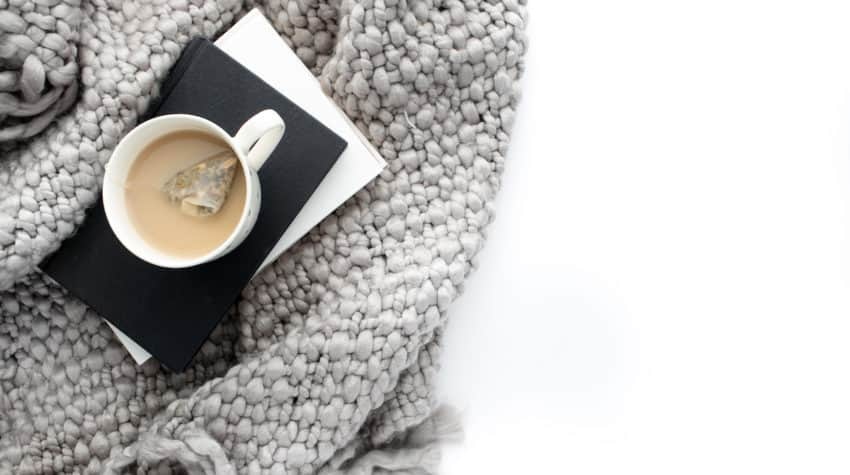 Cozy blanket and hot cup of tea