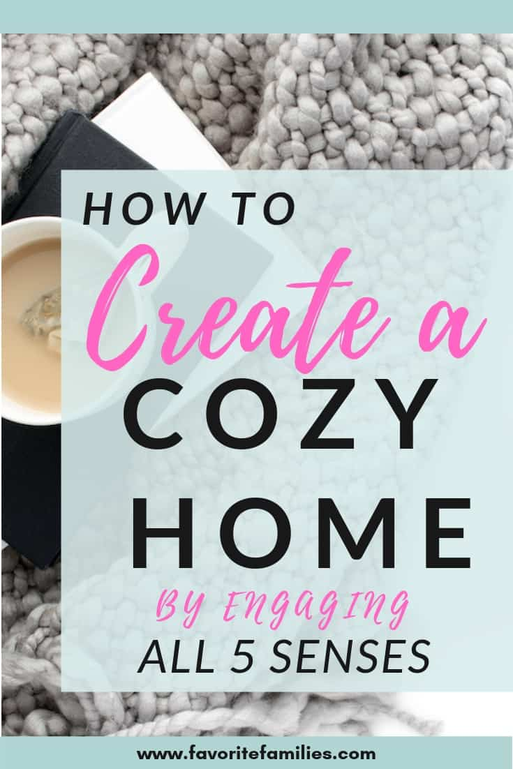 cozy blanket and cup of tea with text overlay how to create a cozy home by engaging all 5 senses
