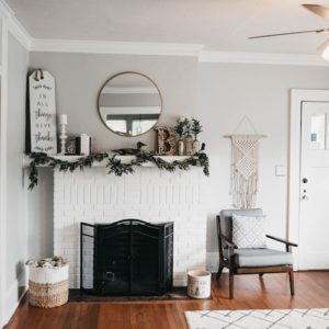 Cozy Home with fireplace draped with greenery