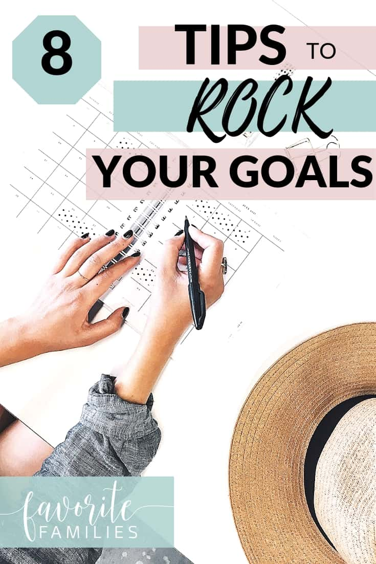 Woman writing in planner with text overlay 8 Tips to Rock Your Goals