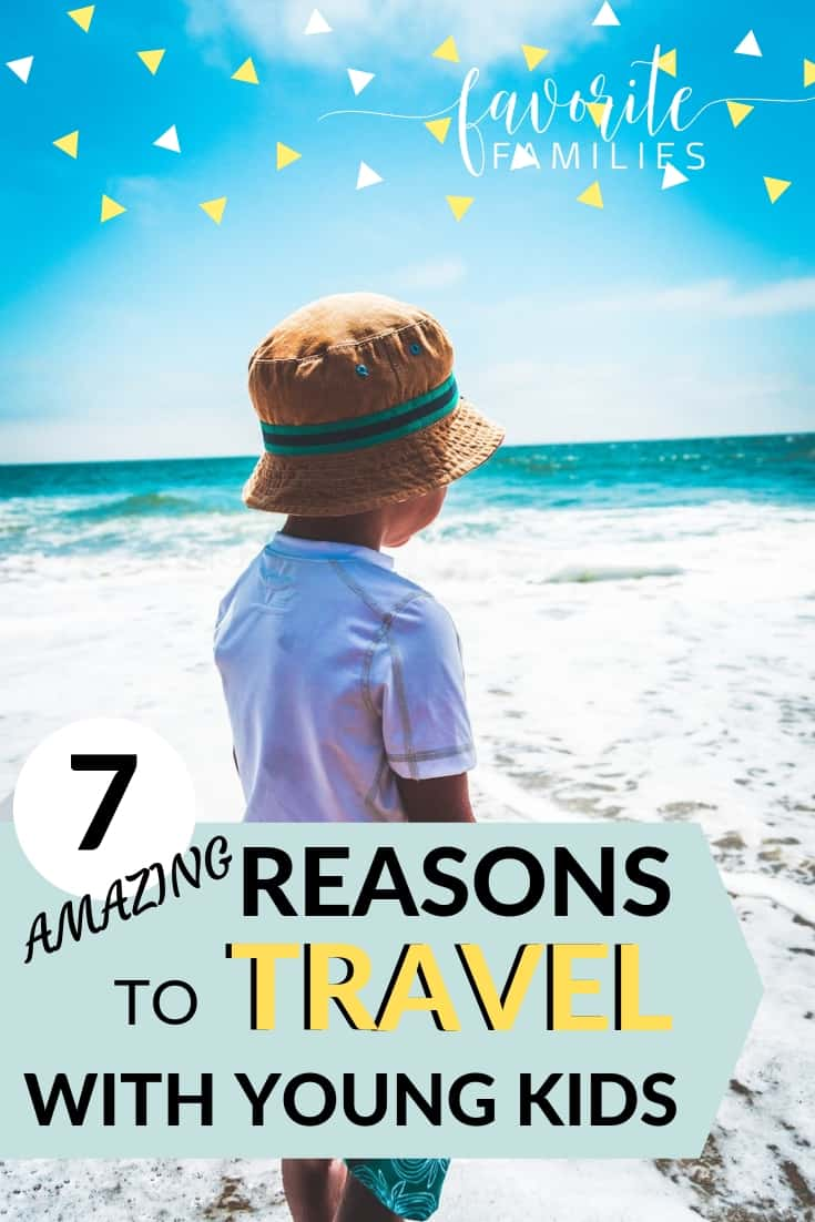 boy at the beach with text overlay 7 reasons to travel with young kids