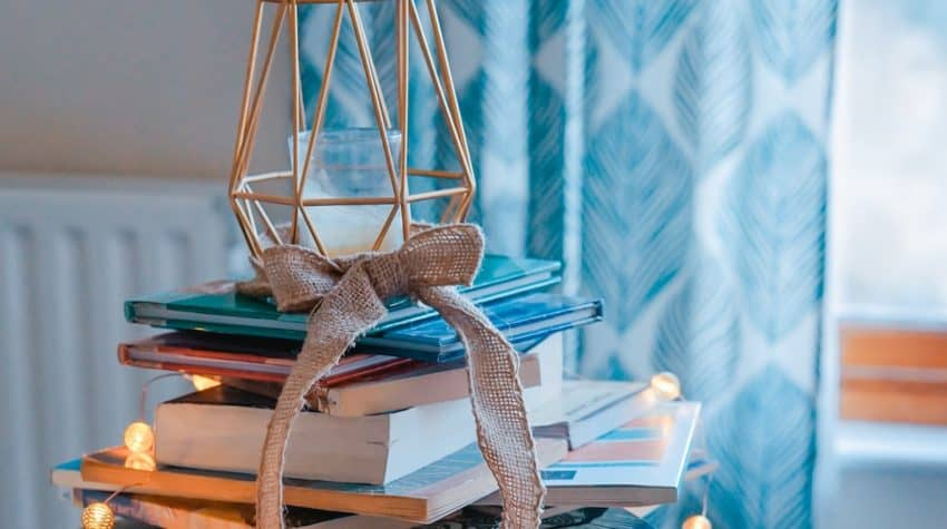 beautiful stack of books decorated with lights