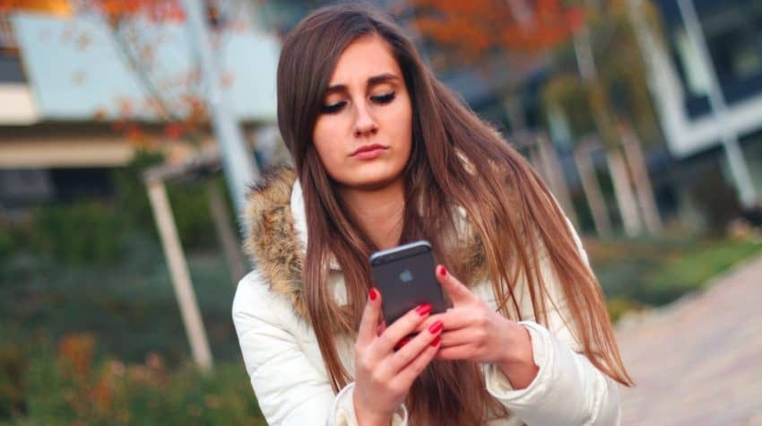 Woman texting about her spouse