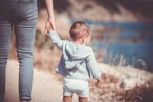 Mom using positive discipline holding sons hand