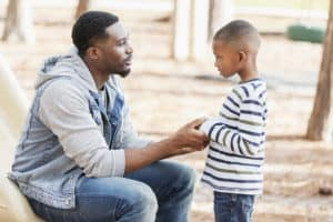 Dad using positive discipline with his son