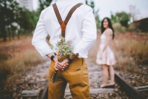 man holding flowers for wife