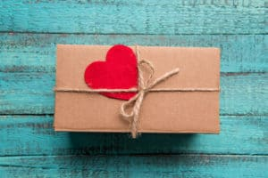 experience gift wrapped on a wooden background