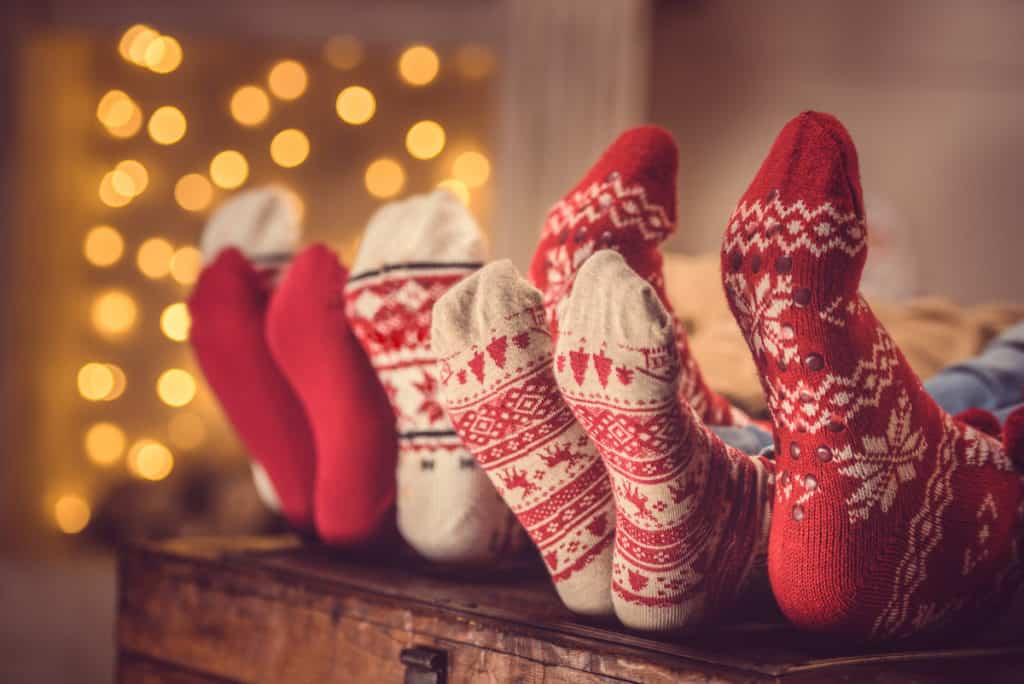 family relaxing and enjoying Christmas with feet up