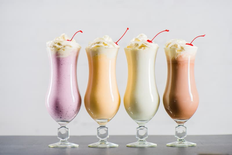 4 milkshakes, strawberry, peach, vanilla, chocolate